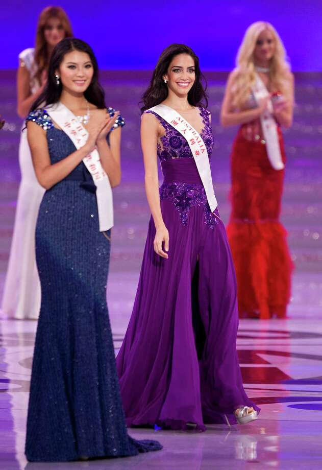 Miss Australia Jessica Kahawaty, center, walks past Miss China Yu Wenxia, left. Yu Wenxia won Miss World 2012, while Jessica Kahawaty was second runner-up. Photo: AP