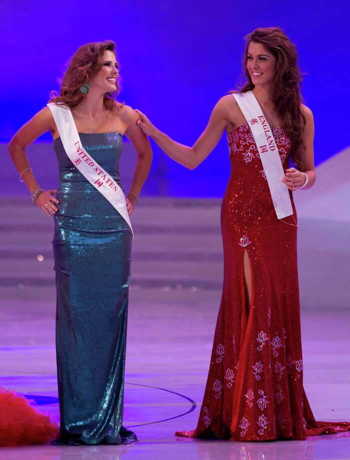 Miss England Charlotte Holmes, right, shares a light moment with Claudine Book of the United States on stage. Photo: AP