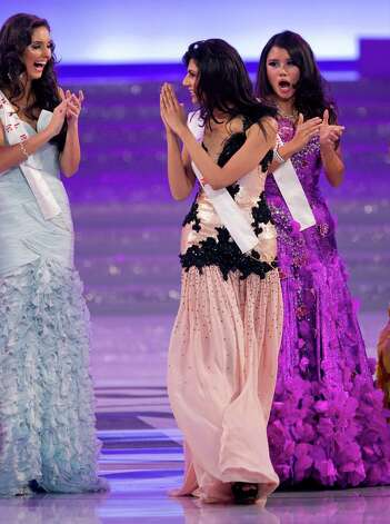 Miss Vanya Mishra of India, center, gestures as she walks on stage. Mishra won the Miss Multimedia and Beauty with a Purpose titles. Photo: AP