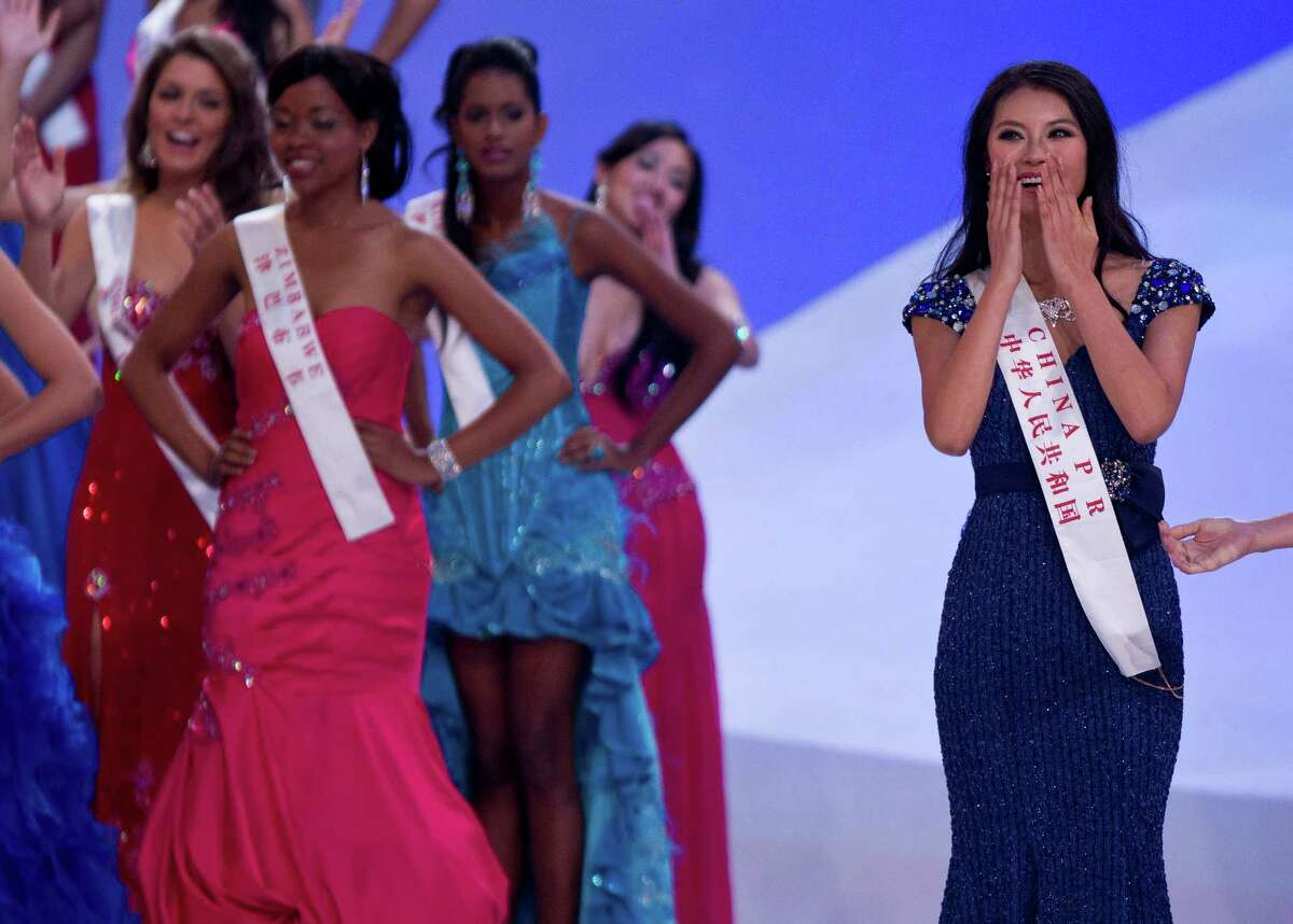 Miss World Yu Wenxia of China, right, reacts after she was announced as a winner.