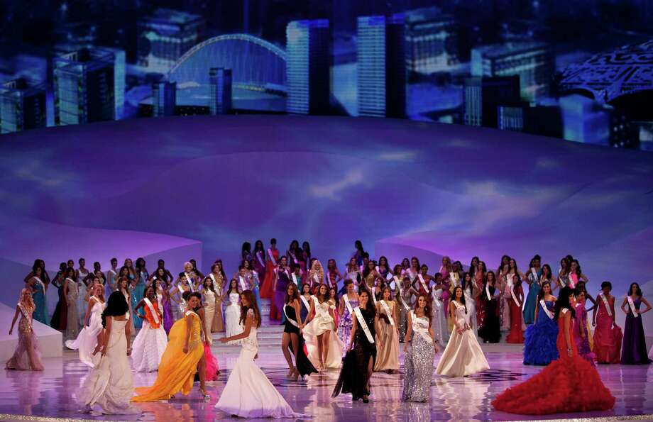 Miss World contestants wearing evening gowns perform on stage. Photo: AP