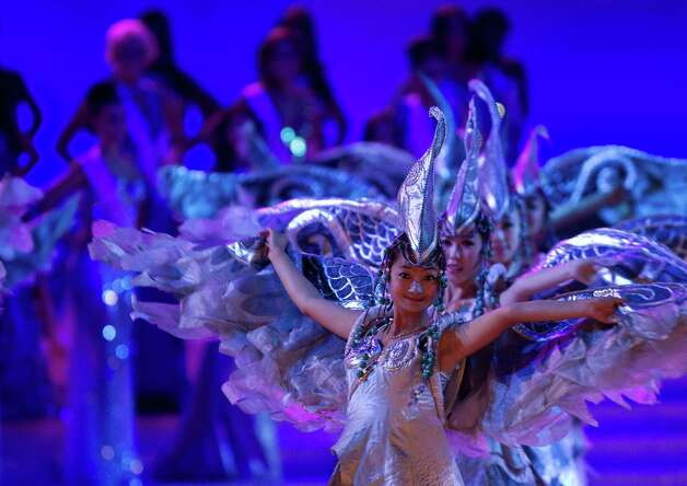 Chinese dancers perform in front of Miss World contestants on stage. Photo: AP