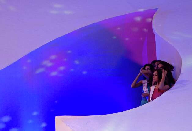 Miss World contestants wait at a stage corner as they prepare to perform on stage. Photo: AP