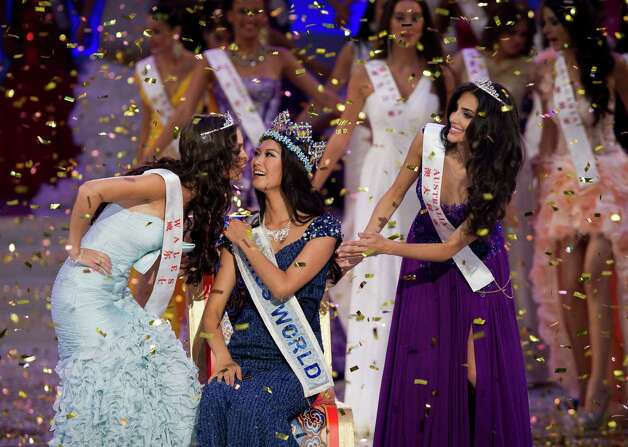 Newly crowned Miss World Yu Wenxia of China, center, is congratulated by first runner-up Miss Wales, Sophie Moulds, left, and second runner-up Miss Australia Jessica Kahawaty, right. Photo: AP