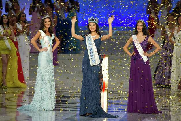 Miss World 2012 winner Yu Wenxia (center) of China waves as she stands next to second place contestent Miss Wales Sophie Moulds (left) and third place Miss Australia Jessica Kahawaty (right). Photo: ED JONES, AFP/Getty Images / 2012 AFP