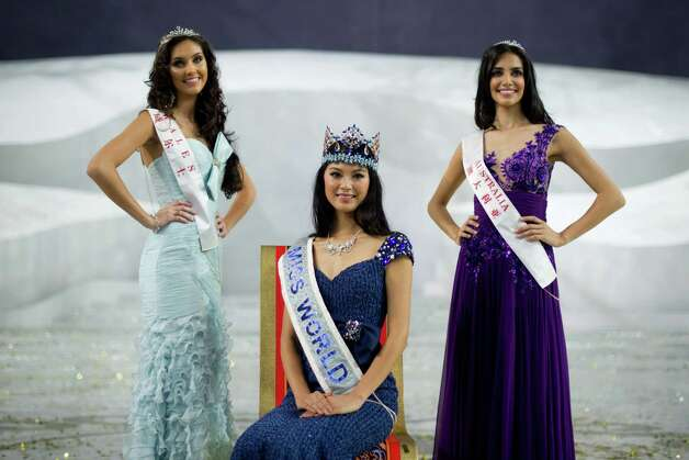 Miss World 2012 winner Yu Wenxia (center) of China, second place contestant Miss Wales Sophie Moulds (left) and third place Miss Australia Jessica Kahawaty (right) pose for photos following the pageant's final ceremony. Photo: ED JONES, AFP/Getty Images / 2012 AFP