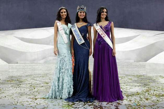 Miss World 2012 winner Yu Wenxia (center) of China, second place contestant Miss Wales Sophie Moulds (left) and third place Miss Australia Jessica Kahawaty (right) pose for photos. Photo: ED JONES, AFP/Getty Images / 2012 AFP