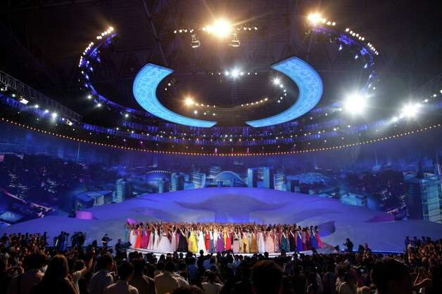 Miss World 2012 contestants wave following the pageant's final ceremony. Photo: ED JONES, AFP/Getty Images / 2012 AFP