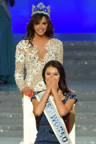 Miss World 2012 winner Yu Wenxia (bottom) of China reacts before receiving the crown from previous winner Ivian Sarcos of Venezuela (top) during the pageant's final ceremony. Photo: ED JONES, AFP/Getty Images / 2012 AFP