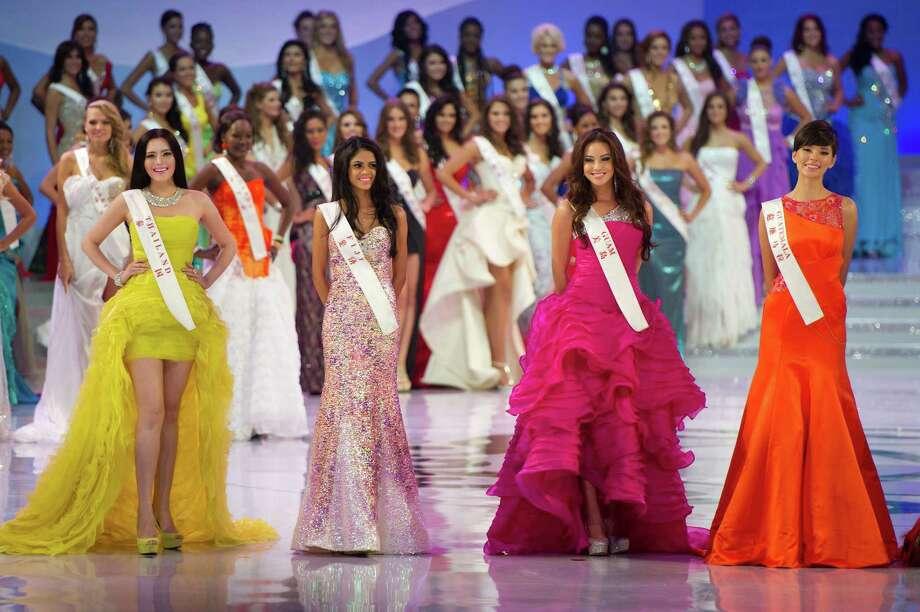 (From left) Miss Thailand Vanessa Phuang, Miss Fiji Koini Vakaloloma, Miss Guam Jeneva Bosko and Miss Guatemala Monique Aparicio Lopez pose. Photo: ED JONES, AFP/Getty Images / 2012 AFP