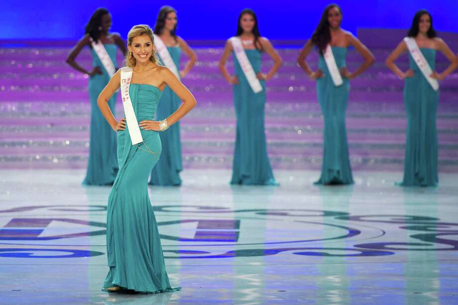 Miss Brazil Mariana Notarangelo parades during the Miss World 2012 final ceremony. Photo: ED JONES, AFP/Getty Images / 2012 AFP
