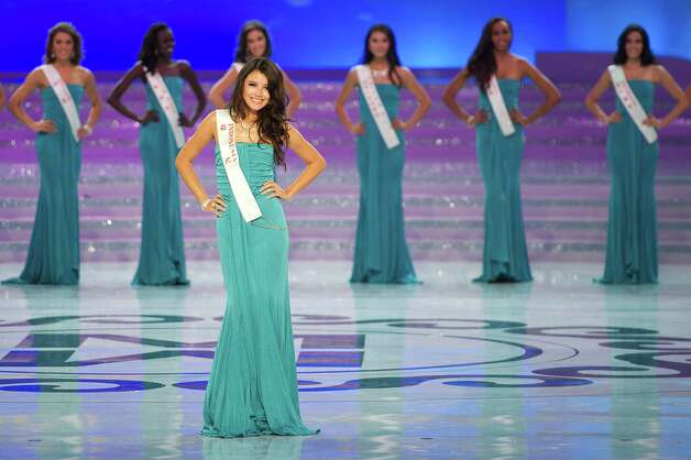 Miss Indonesia Ines Putri Tjiptadi parades during the Miss World 2012 final ceremony. Photo: ED JONES, AFP/Getty Images / 2012 AFP