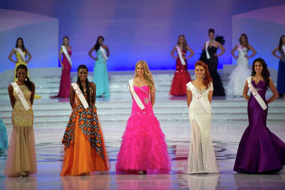 (From left) Miss Gabon Marie Noelle Ada Meyo, Miss Cote d'Ivoire Hadjau Helene-Valerie, Miss Finland Sabina Sarkka, Miss France Delphine Wespiser and Miss Colombia Barbara Turbay pose. Photo: ED JONES, AFP/Getty Images / 2012 AFP