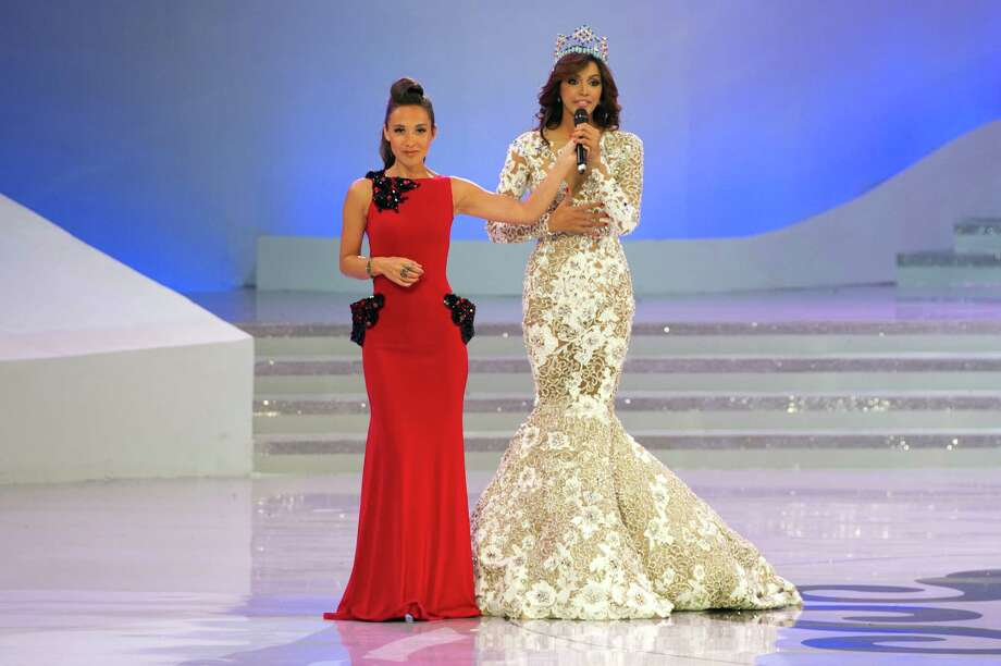 Miss World 2012 host Mylene Klass (left) of Britain holds a microphone for Miss World 2011 winner Ivian Sarcos of Venezuela during the pageant's final ceremony. Photo: ED JONES, AFP/Getty Images / 2012 AFP