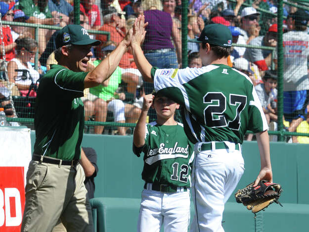 Coach Bill Meury high fives pitcher Matt Kubel after an inning, during 2012 Little League World Series game action against Midwest in South Williamsport, Penn. on Saturday August 18, 2012. Photo: Christian Abraham / Connecticut Post
