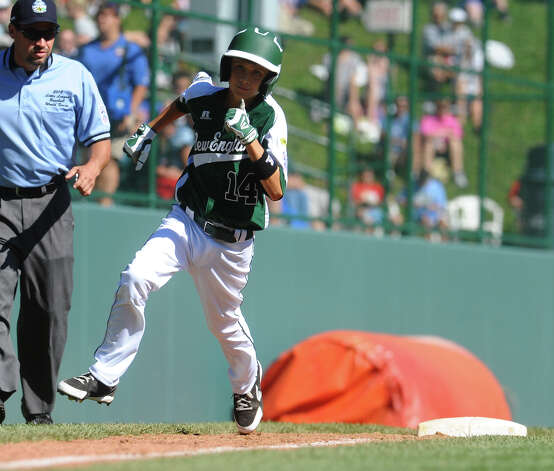 New England's #14 Chris Meyers heads to home plate, during 2012 Little League World Series game action against Midwest in South Williamsport, Penn. on Saturday August 18, 2012. Photo: Christian Abraham / Connecticut Post