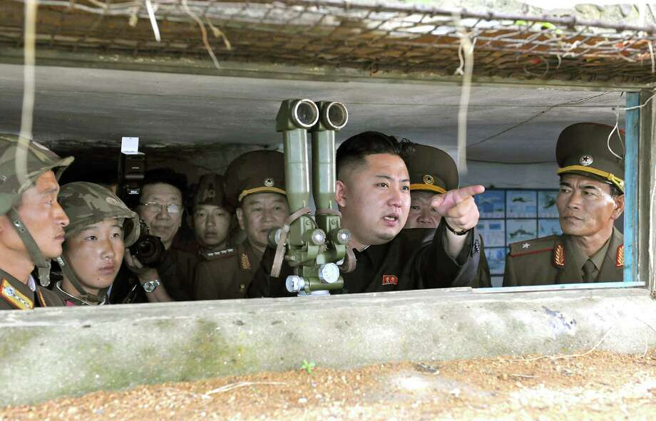 "This undated photo released by North Korea's official Korean Central News Agency (KCNA) on August 18, 2012 shows North Korean leader Kim Jong-Un (C) looking towards the South Korean side from a watch post as he inspects island defence detachments stationed in the southernmost part of the southwest front.  ----EDITORS NOTE   RESTRICTED TO EDITORIAL USE - MANDATORY CREDIT  "" AFP PHOTO / KCNA via KNS "" - NO MARKETING NO ADVERTISING CAMPAIGNS - DISTRIBUTED AS A SERVICE OT CLIENTS---- AFP PHOTO / KCNA via KNSKCNA VIA KNS/AFP/GettyImages Photo: KCNA VIA KNS, AFP/Getty Images / AFP"
