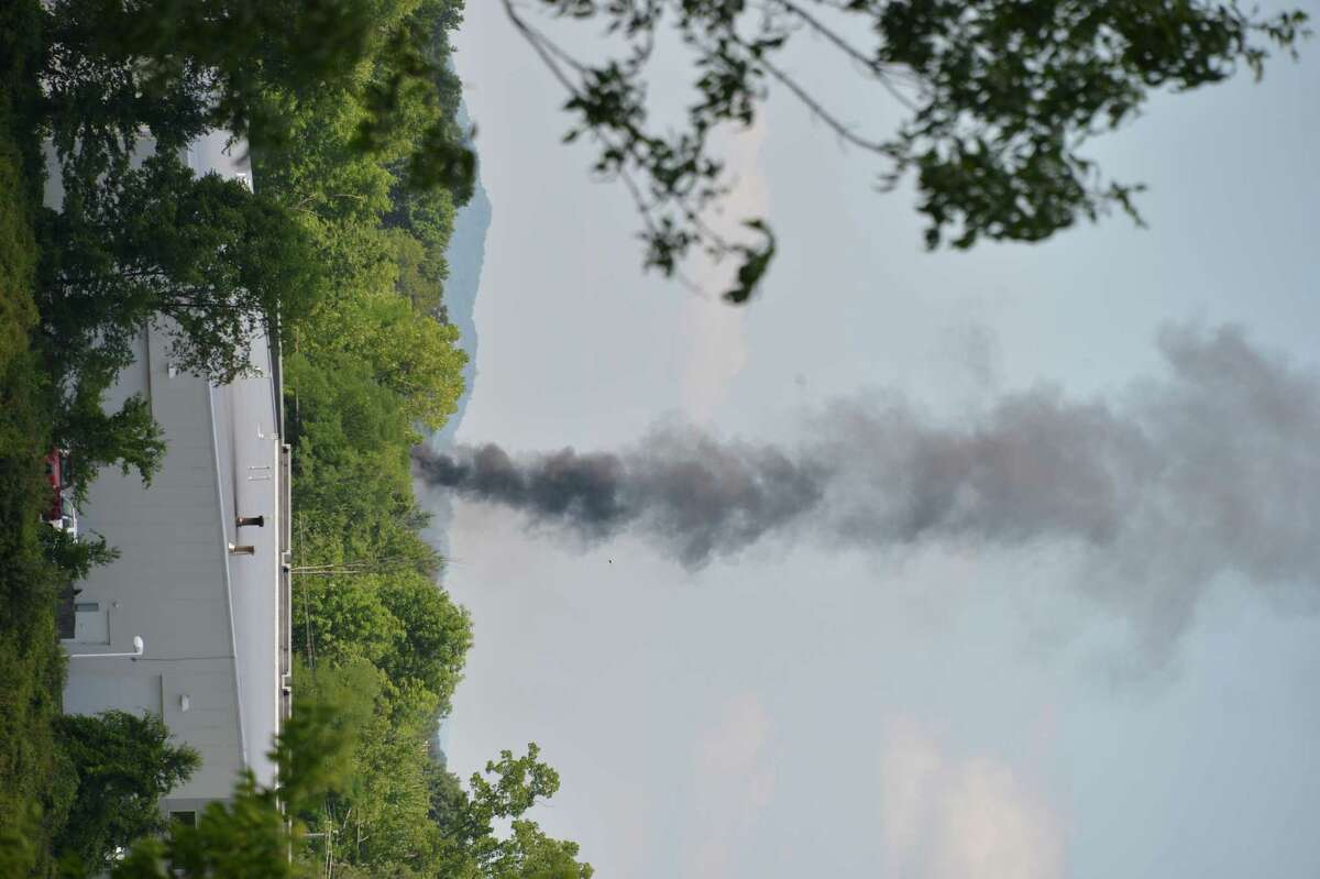 A plume of heavy black smoke can be seen rising from a chemical fire at TCI, a transformer recycling company in Ghent Thursday Aug. 2, 2012. (John Carl D'Annibale/ Times Union)