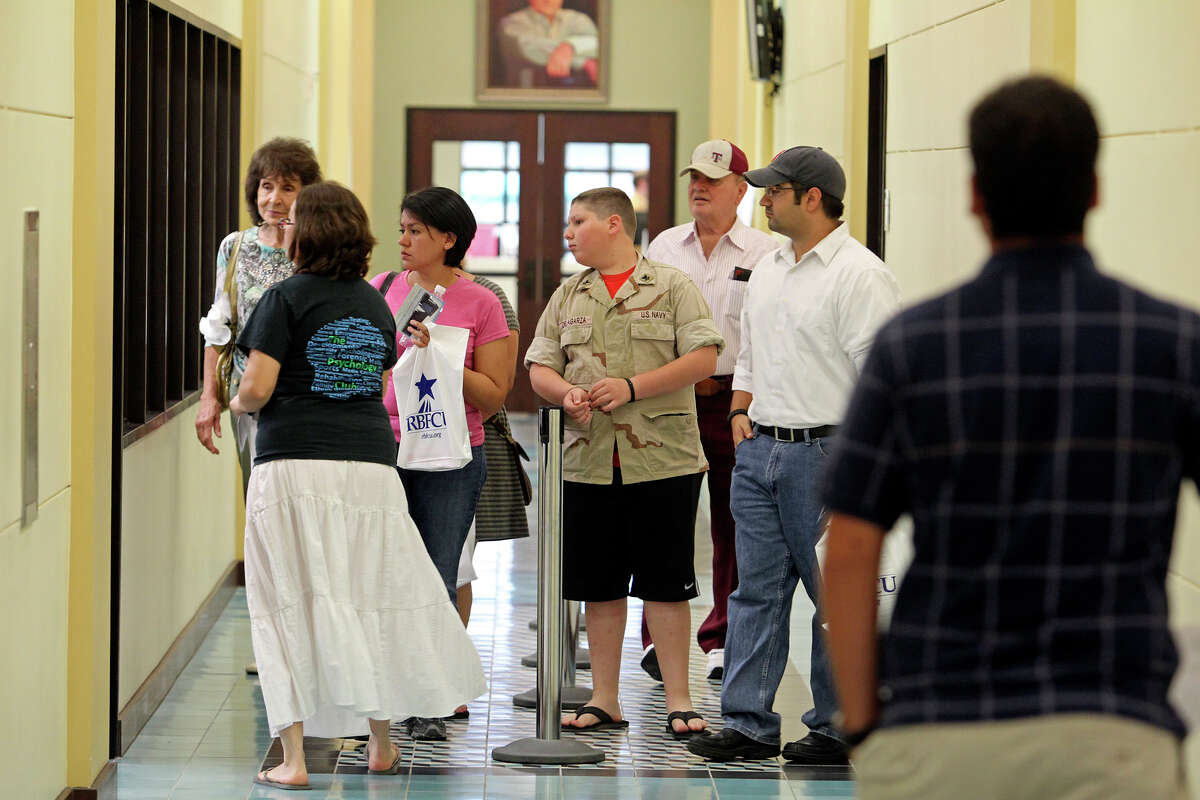 A tour group moves through the lower level as Texas A&M University - San Antonio offers an open house to prospective students on July 27, 2012.