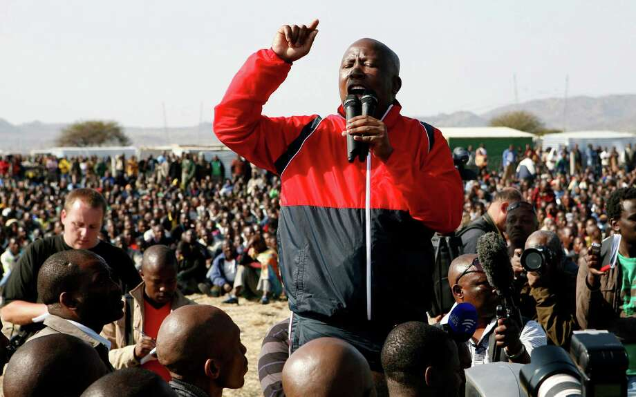 Former youth leader of the African National Congress (ANC) Julius Malema addresses mine workers at the Lonmin mine near Rustenburg, South Africa, Saturday, Aug. 18, 2012. Miners and their families welcomed expelled politician Malema on Saturday as he told the thousands who gathered at the site where 34 miners were killed this week that South African police had no right to fire the live bullets that killed them. (AP Photo/Themba Hadebe) Photo: Themba Hadebe, Associated Press / AP