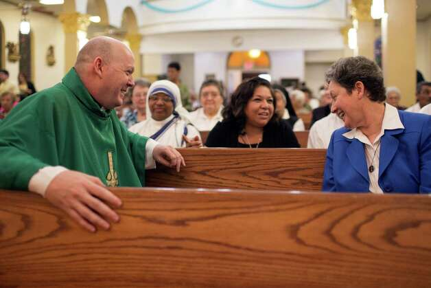 Father Brendan Cahill, left, along with Sister Kevina Keating, Superintendent of the Catholic school, share a laugh with friends, prior to the 100th anniversary mass, Saturday, August 18, 2012 at Our Lady of Guadalupe Catholic Church in Houston, Texas. (TODD SPOTH) Photo: TODD SPOTH, TODD SPOTH / PHOTOGRAPHER / © TODD SPOTH, 2012
