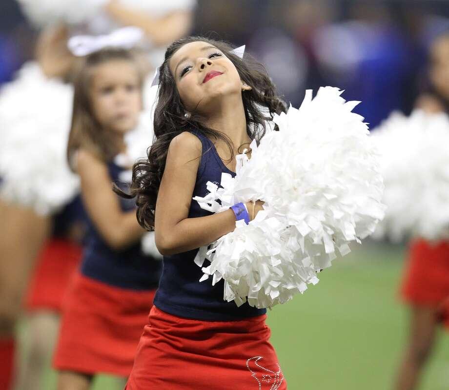 Texans Junior Cheerleader Alena S., 7, performs with the Texans cheerleaders. (Karen Warren / Chronicle)