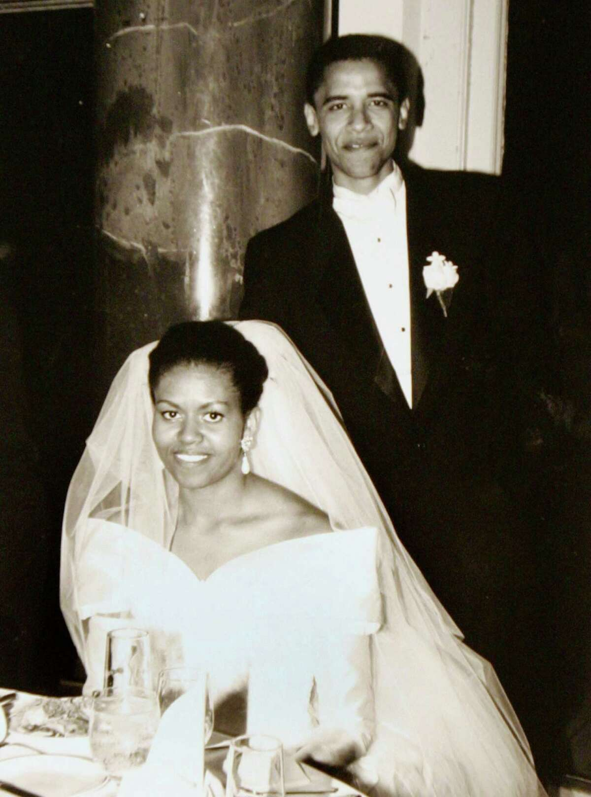 In this Oct. 18, 1992, photo released by the Obama for America campaign shows Barack Obama and his bride Michelle Robinson on their wedding day in Chicago.