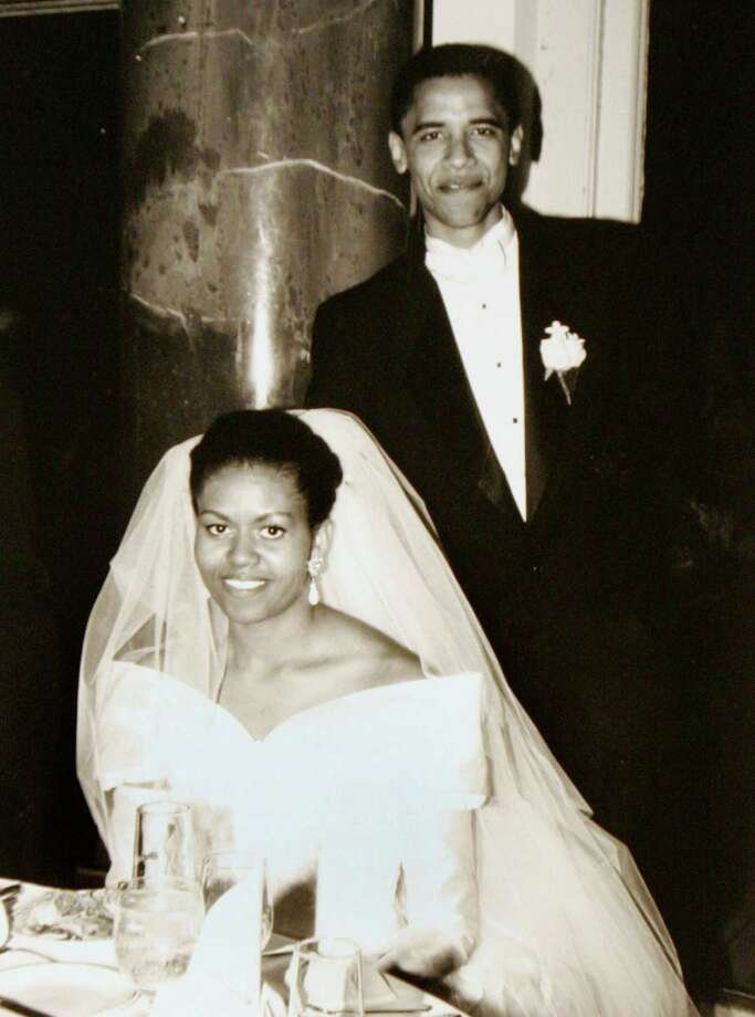 In this Oct. 18, 1992, photo released by the Obama for America campaign shows Barack Obama and his bride Michelle Robinson on their wedding day in Chicago.  Photo: Anonymous