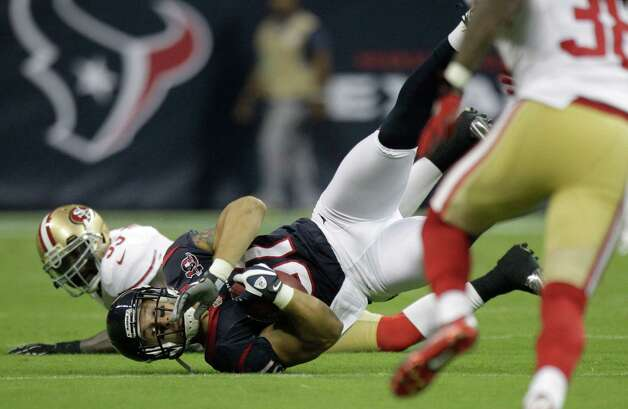Houston Texans tight end Owen Daniels (81) makes a catch as San Francisco 49ers linebacker NaVorro Bowman (53) looks on during the first quarter of an NFL football game at Reliant Stadium on Saturday, Aug. 18, 2012, in Houston. Photo: Brett Coomer, Houston Chronicle / © 2012  Houston Chronicle
