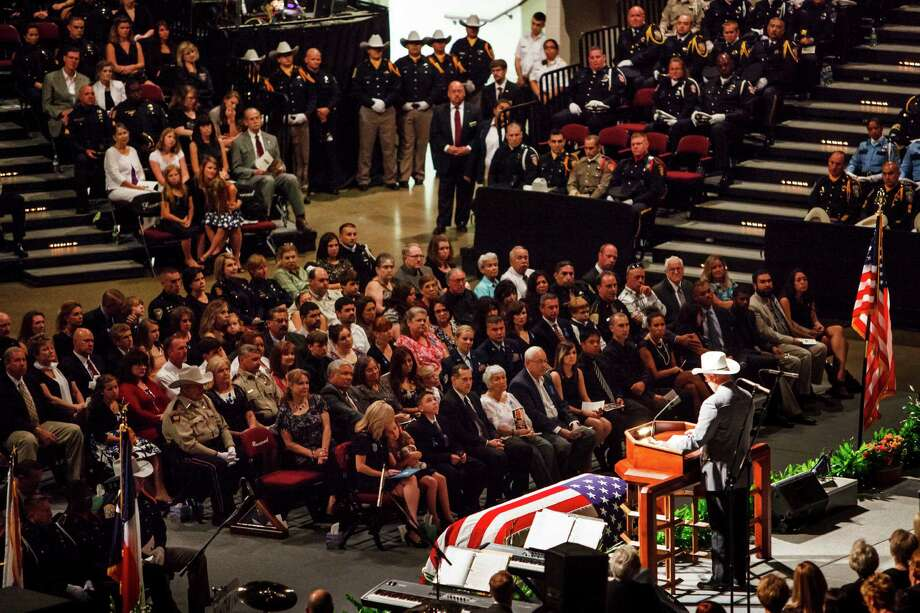 Brazos County Sheriff Chris Kirk speaks about the life of Brian Bachmann during Saturday's funeral for the county constable at Texas A&M University.  Bachmann was shot to death while serving an eviction notice Monday. Photo: Michael Paulsen / © 2012 Houston Chronicle