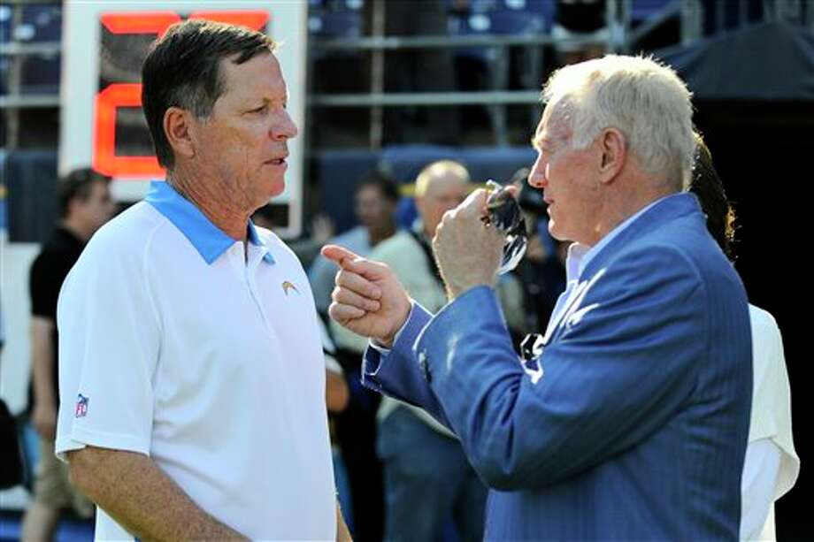 Dallas Cowboys owner Jerry Jones talks with San Diego Chargers coach Norv Turner prior to the start of a NFL preseason football game Saturday, Aug. 18, 2012 in San Diego. (AP Photo/Denis Poroy) Photo: Associated Press