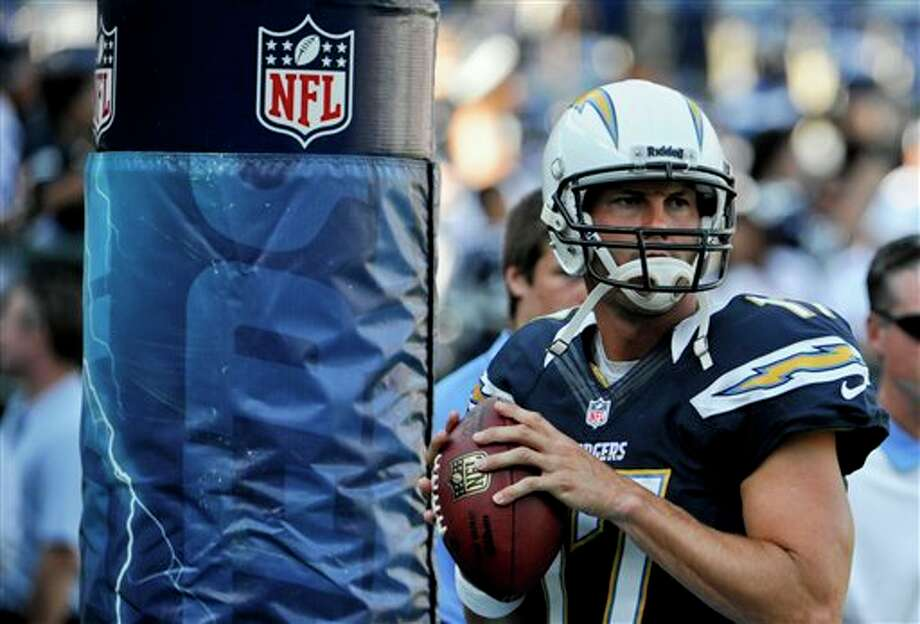 San Diego Chargers quarterback Philip Rivers warms up before a NFL preseason football game against the Dallas Cowboys, Saturday, Aug. 18, 2012 in San Diego. (AP Photo/Denis Poroy) Photo: Associated Press
