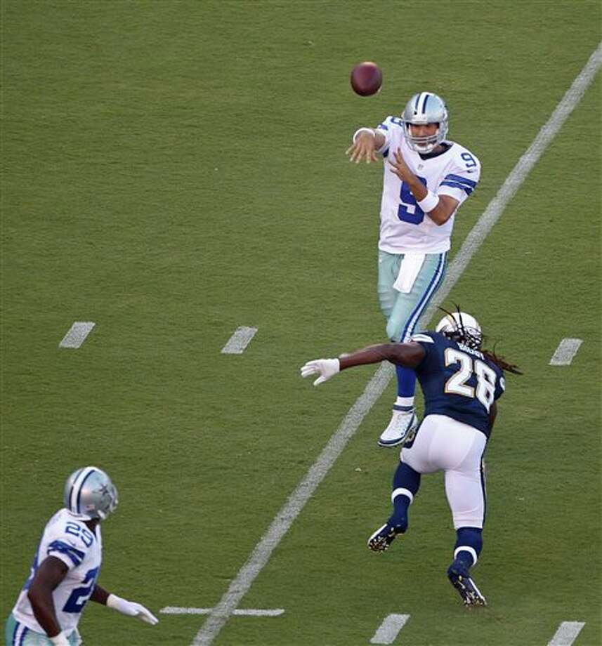 Dallas Cowboys quarterback Tony Romo throws a pass over San Diego Chargers defensive back Atari Bigby to running back DeMarco Murray in the flat during the first quarter of a NFL preseason football game Saturday, Aug. 18, 2012 in San Diego. (AP Photo/Lenny Ignelzi) Photo: Associated Press