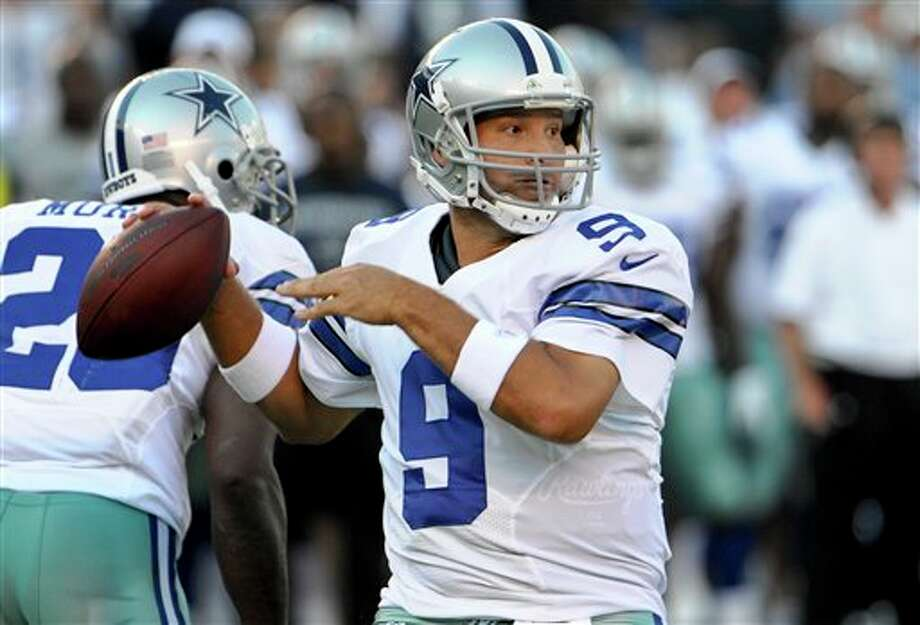 Dallas Cowboys quarterback Tony Romo looks for a receiver during the first quarter of a NFL preseason football game against the San Diego Chargers Saturday, Aug. 18, 2012 in San Diego. (AP Photo/Denis Poroy) Photo: Associated Press