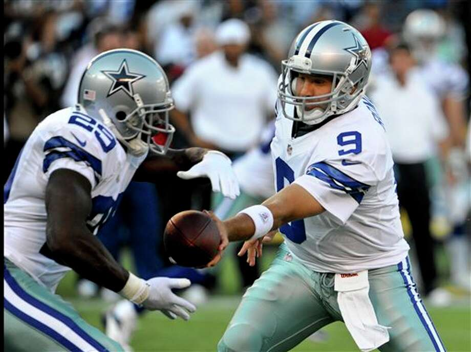 Dallas Cowboys quarterback Tony Romo makes the handoff to running back DeMarco Murray during the Cowboys first possession against the San Diego Chargers during the first quarter of a NFL preseason football game Saturday, Aug. 18, 2012 in San Diego. (AP Photo/Denis Poroy) Photo: Associated Press