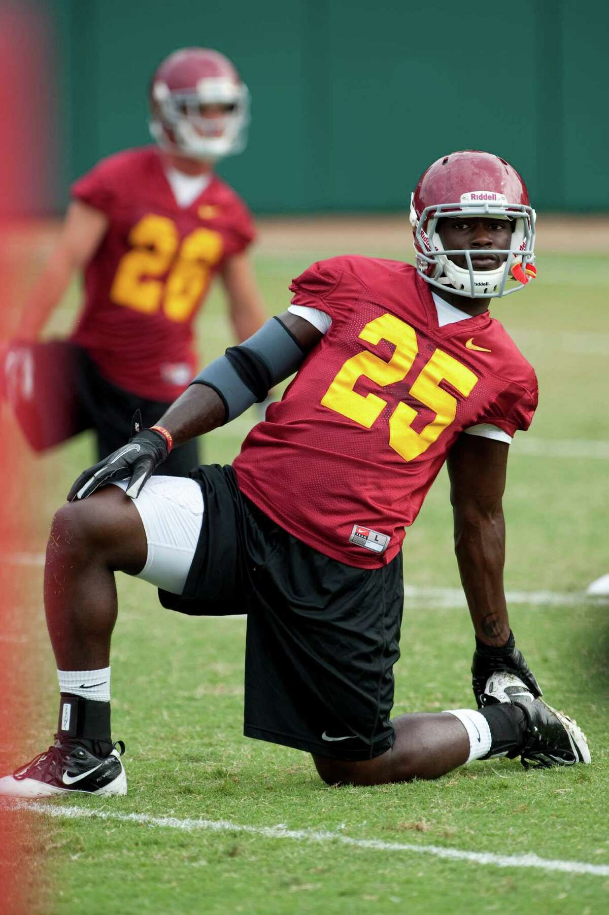 Southern California running back Silas Redd stretches during NCAA college football practice in Los Angeles, Friday, Aug. 17, 2012. (AP Photo/Grant Hindsley)