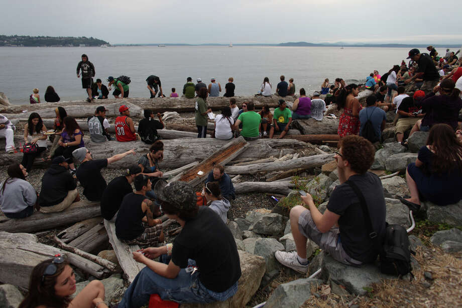 People gather among the driftwood. Photo: JOSHUA TRUJILLO / SEATTLEPI.COM