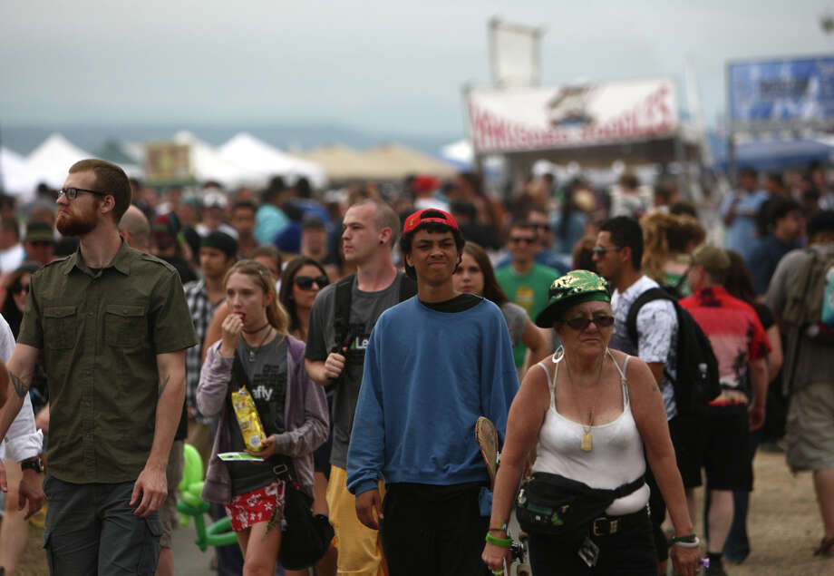 People walk among vendor booths. Photo: JOSHUA TRUJILLO / SEATTLEPI.COM