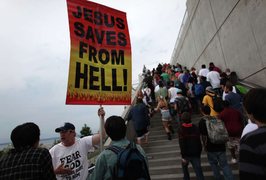 People preach at the enterance. Photo: JOSHUA TRUJILLO / SEATTLEPI.COM