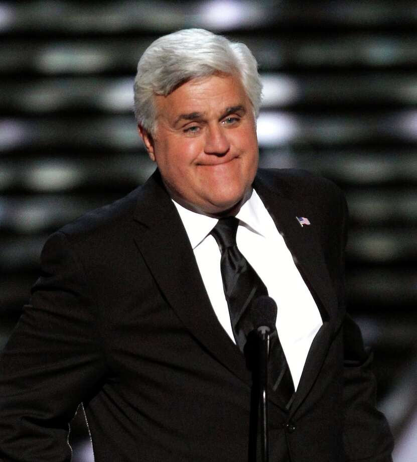 FILE - In this Wednesday, July 13, 2011 file photo, Jay Leno presents the Jimmy V Award for Perseverance at the ESPY Awards  in Los Angeles. Published reports say The Tonight Show has laid off about two dozen workers and host Jay Leno has taken a large pay cut to save the jobs of other staffers, Saturday, Aug. 18, 2012. (AP Photo/Matt Sayles, File) Photo: Matt Sayles, Associated Press / AP