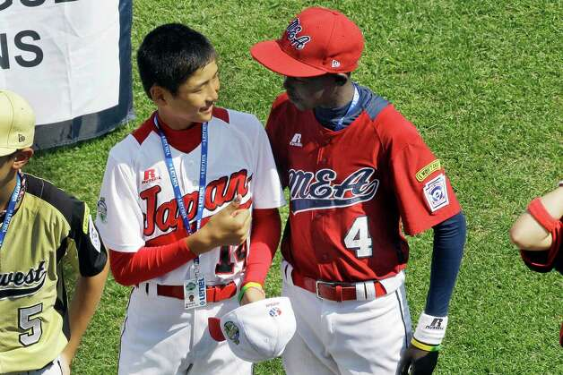 Japan's Shun Oshima, left, and Uganda's Tonny Okello greet each other during opening ceremonies. (AP Photo/Gene J. Puskar) Photo: Gene J. Puskar, Associated Press / AP