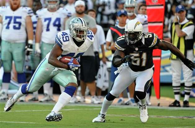 Dallas Cowboys running back Jamize Olawale races away from San Diego Chargers linebacker Takeo Spikes during the first half of a NFL preseason football game Saturday, Aug. 18, 2012 in San Diego. (AP Photo/Denis Poroy) Photo: Associated Press