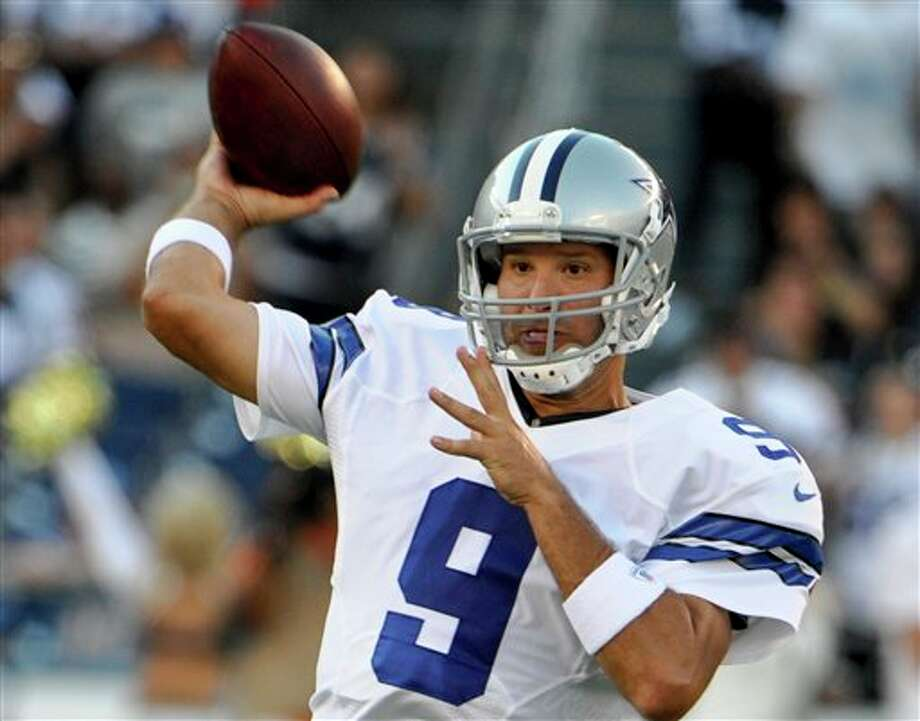 Dallas Cowboys quarterback Tony Romo throws a pass during the first half  of a NFL preseason football game Saturday, Aug. 18, 2012 in San Diego. (AP Photo/Denis Poroy) Photo: Associated Press