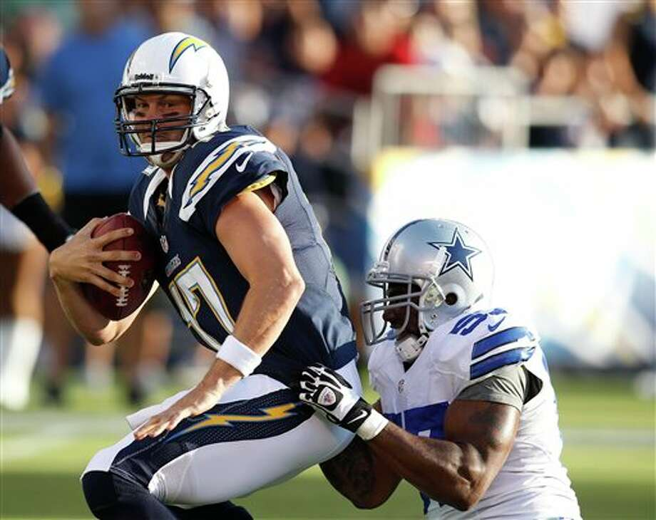 San Diego Chargers quarterback Philip Rivers is sacked by Dallas Cowboys linebacker Victor Butler during the first quarter of a NFL preseason football game Saturday, Aug. 18, 2012 in San Diego. (AP Photo/Chris Park) Photo: Associated Press