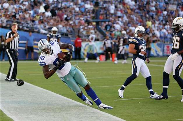 Dallas Cowboys wide receiver Dez Bryant appears to get both feet down inbounds while making a touchdown reception against the San Diego Chargers during the first half of a NFL preseason football game Saturday, Aug. 18, 2012 in San Diego. The play was nullified by a holding penalty on the Cowboys. (AP Photo/Chris Park) Photo: Associated Press