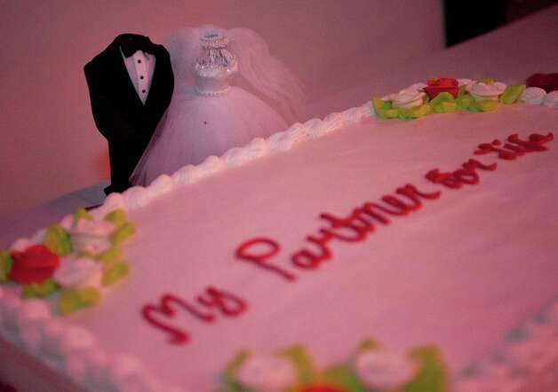 Headless groom and bride figurines stand behind a cake, Saturday, Aug. 18, 2012, at Wax Club Lounge in San Antonio. Photo: Darren Abate, Darren Abate/For The Express-New