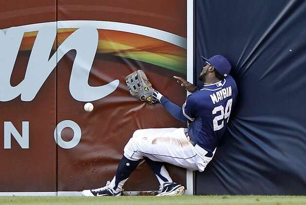 San Diego Padres center fielder Cameron Maybin can't make the catch at the wall on a triple by San Francisco Giants' Pablo Sandoval during the third inning of a baseball game in San Diego, Saturday, Aug. 18, 2012. (AP Photo/Alex Gallardo) Photo: Alex Gallardo, Associated Press
