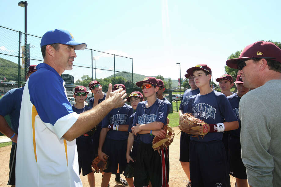 Former major-league pitcher Mike Mussina (left) shares his knowledge with the McAllister Park All-Stars at Saturday's practice. Photo: Jerry Lara, Express-News / © 2012 San Antonio Express-News