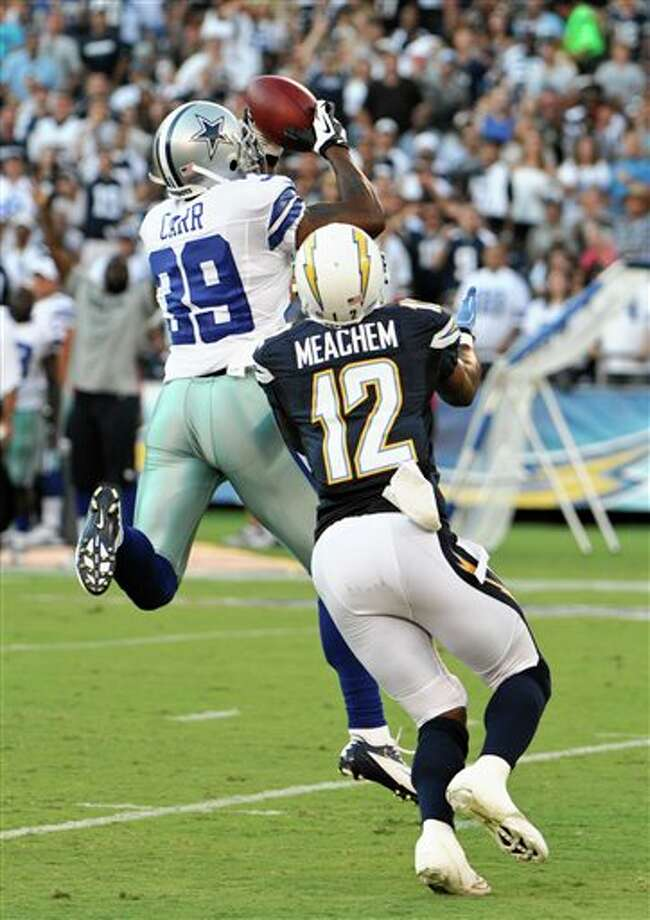 Dallas Cowboys defensive back Brandon Carr picks off a pass in frint of San Diego Chargers wide receiver Robert Meachem during the first half of a NFL preseason football game Saturday, Aug. 18, 2012 in San Diego. (AP Photo/Denis Poroy) Photo: Associated Press