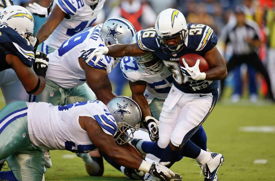 San Diego running back Curtis Brinkley avoids a Dallas defender in helping lead the Chargers past the Cowboys 28-20 on Saturday night. Photo: Chris Park / FR121015 AP